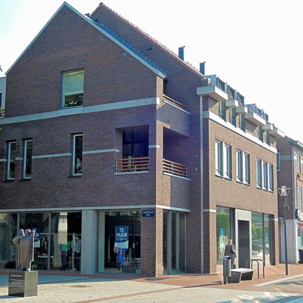 Nieuwbouw commerciële ruimte met bovenwoningen te Deurne